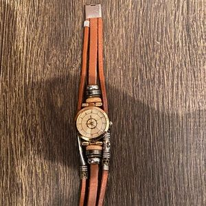 brown watch bracelet (doesn't actually tell time)